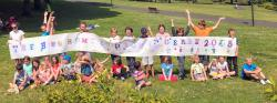 Some of the children at the Derry Picnic posing with the sign they made