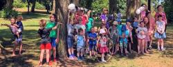 Some of the Children at the Belfast Picnic, posing by the trees and hanging aign