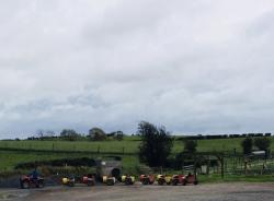 Barrelling along in the distance  - children being towed by the tractor